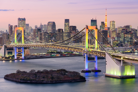 Tokyo, Japan skyline with Rainbow Bridge and Tokyo Tower.
