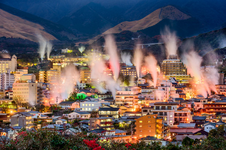 Beppu, Japan cityscape with hot spring bath houses with rising steam. Stok Fotoğraf
