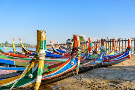 teakwood: Mandalay, Myanmar boats on the  Taungthaman Lake in front of U Bein Bridge. Stock Photo