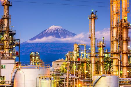 Mt. Fuji, Japan viewed from behind factories. Standard-Bild
