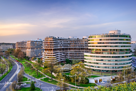 scandal: WASHINGTON, D.C. - APRIL 11, 2015: The Watergate Complex in Foggy Bottom. The complex became well known in the wake of the Watergate Scandal which led to President Richard Nixons resignation in 1974.