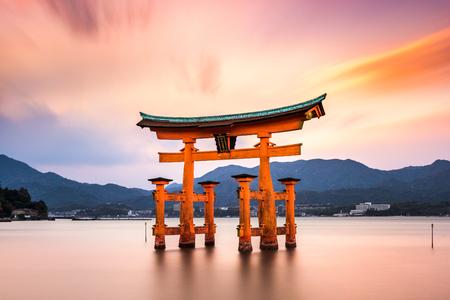 shinto: Miyajima, Hiroshima, Japan at the floating gate of Itsukushima Shrine. (gate sign reads Itsukushima Shrine)
