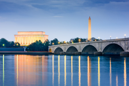 night view: Washington DC, USA skyline on the Potomac River with Lincoln Memorial, Washington Monument, and Arlington Memorial Bridge. Editorial