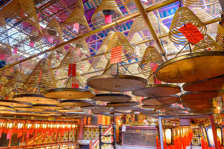 HONG KONG, CHINA - MAY 17, 2014: The interior of Man Mo Temple. Established in 1847, the temple is dedicated to the civil god Man Cheong and the martial god Kwan Tai. Editorial
