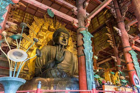 zen interior: NARA, JAPAN - NOVEMBER 19, 2015: The Todaiji Buddha. It is considered the worlds largest bronze statue of the Buddha Vairocana. Editorial