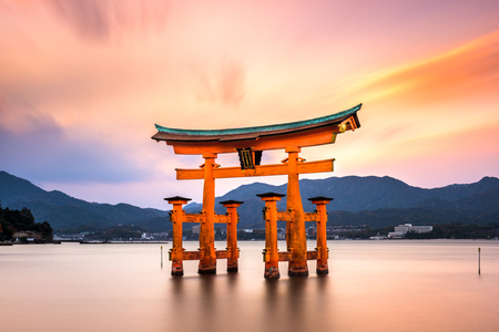 Miyajima, Hiroshima, Japan at the great gate of Itsukushima shrine. (inscription reads Itsukushima Shrine) Editorial