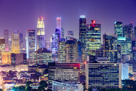 futuristic city: Singapore Financial District skyline at night.