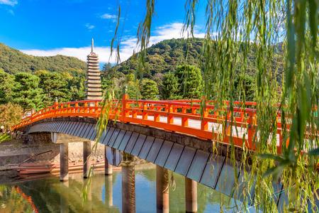 Uji, Kyoto, Japan at the Uji River and thirteen storied pagoda. Stock Photo - 53354322