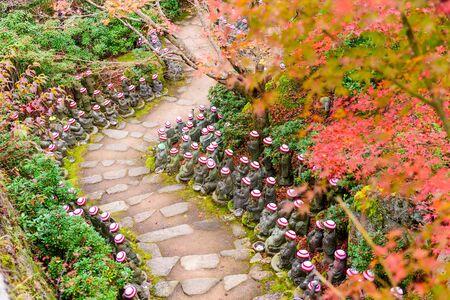 pathway: Miyajima Island, Hiroshima, Japan at the buddha lined pathways at Daisho-in Temple grounds.