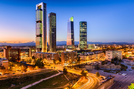 torres: Madrid, Spain financial district skyline at twilight.