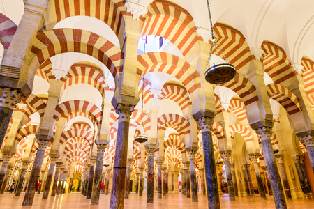 regarded: CORDOBA, SPAIN - November 10, 2014: Hypostyle Hall in the Mosque-Cathedral of Cordoba. The structure is regarded as one of the most accomplished monuments of Moorish architecture. Editorial