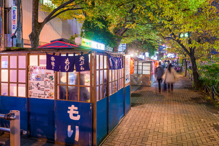 the stands: FUKUOKA, JAPAN - DECEMBER 5, 2015: Food stands, locally called yatai line Nakasu Island. Editorial
