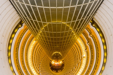 five star: SHANGHAI, CHINA - JUNE 18, 2014: The Grand Hyatt Shanghai viewed from atop the atrium. The 33-story atrium is one of the highest in the world. Editorial