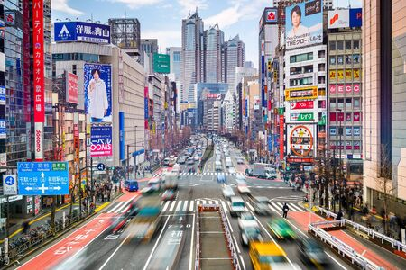 commercial district: TOKYO, JAPAN - MARCH 18, 2014: Traffic at Shinjuku district. Shinjuku is the commercial and administrative center of the city. Editorial