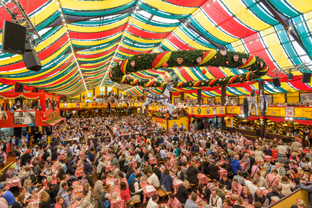 halls: MUNICH, GERMANY - SEPTEMBER 30, 2013: Crowds in the Hippodrom Beer Tent on the Theresienwiese Oktoberfest fair grounds. The Hippodrom was first opened in 1902.