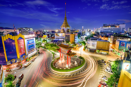 BANGKOK, THAILAND - SEPTEMBER 23, 2015: Traffic passes through Chinatown at Odeon Roundabout. The roundabout marks one end of Chinatown.