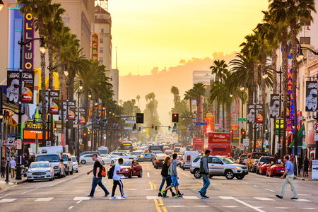walk of fame: LOS ANGELES, CALIFORNIA - MARCH 1, 2016: Traffic on Hollywood Boulevard at dusk. The theater district is famous tourist attraction. Editorial