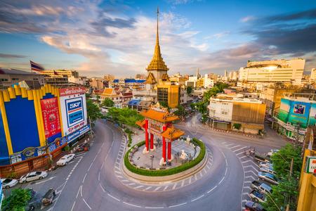 BANGKOK, THAILAND - SEPTEMBER 23, 2015: The Chinatown traffic circle with Wat Traimit behind.