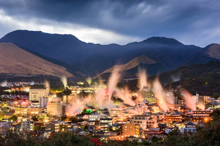 ryokan: Beppu, Japan cityscape with hot spring bath houses with rising steam. Stock Photo
