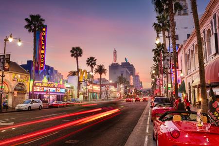 LOS ANGELES, CALIFORNIA - MARCH 1, 2016: Traffic on Hollywood Boulevard at dusk. The theater district is famous tourist attraction. 에디토리얼
