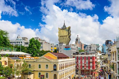 MACAU, CHINA - MAY 21, 2014: Crowds below the skyline of Macau. The former Portuguese coloy is a popular tourist attraction Editorial