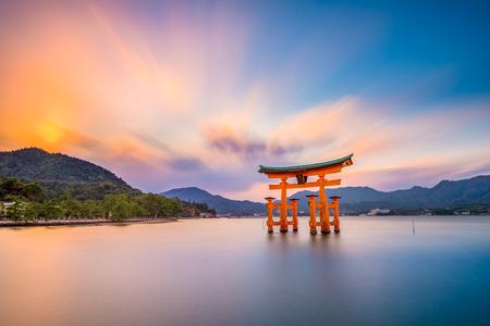 Miyajima, Hiroshima, Japan at the floating gate of Itsukushima Shrine. (gate sign reads Itsukushima Shrine)