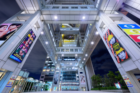 TOKYO, JAPAN - DECEMBER 22, 2016: The plaza below Fuji TV Headquarters at night on Odaiba Island. Fuji TV is one of Japan's nationwide TV stations.