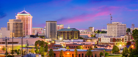 office buildings: Montgomery, Alabama, USA downtown skyline at night.