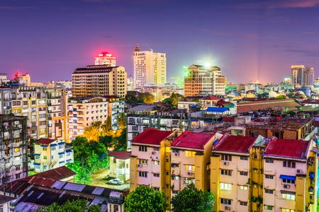 districts: Yangon, Myanmar downtown business district skyline.