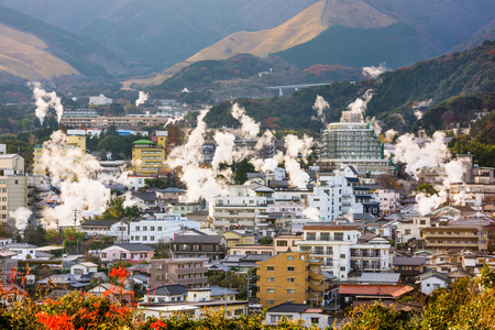 districts: Beppu, Japan cityscape with hot spring bath houses.