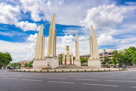 monument: BANGKOK, THAILAND - OCTOBER 8, 2015: The Democracy Monument and traffic circle. The monument dates from 1939 and commemorates the 1932 Siamaese Revolution.