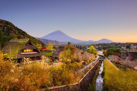 saiko: Mt. Fuji, Japan with historic village Iyashi no Sato during autumn. Stock Photo