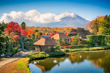 Oshino, Japan historic thatch roof farmhouses with Mt. Fuji.