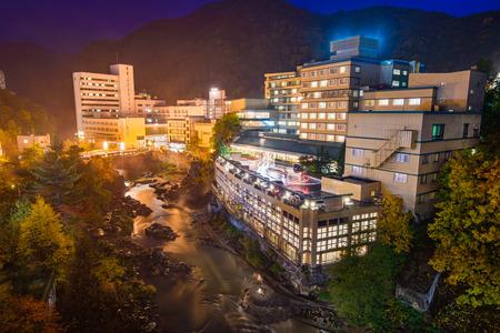 sapporo: Jozankei, Japan hot springs resort town at night. Stock Photo