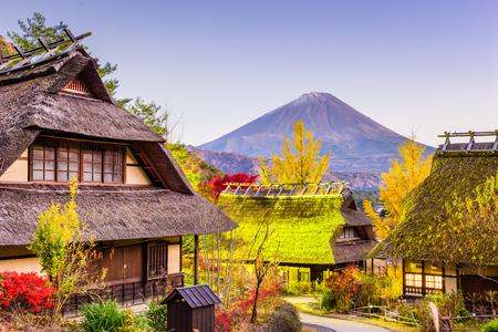 saiko: Mt. Fuji, Japan with historic village Iyashi no Sato during an autumn twilight. Stock Photo