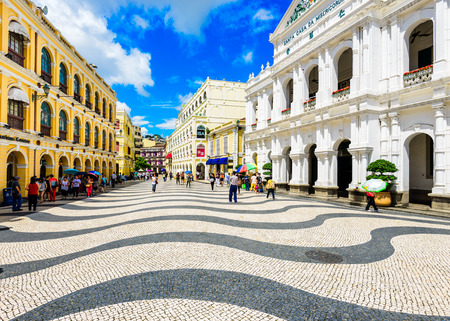 MACAU, CHINA - MAY 21, 2014: People enjoy Senado Square. The territory was the last European colony in Asia and the architecture is inspired by the former Portuguese rule. Editorial