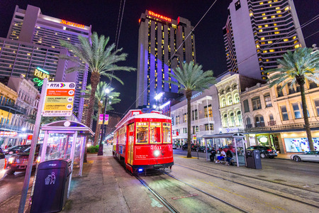 streetcar: NEW ORLEANS, LOUISIANA - MAY 10, 2016: A streetcar in downtown New Orleans on Canal Street. Streetcars have been an integral part of New Orleans transportation since the early 19th century.