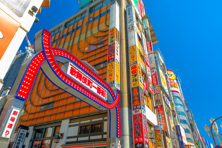 TOKYO, JAPAN - MARCH 15, 2014: Sign marking the entrance to the main alleyway in Kabuki-cho. The area is a renown nightlife and red-light district. Editorial