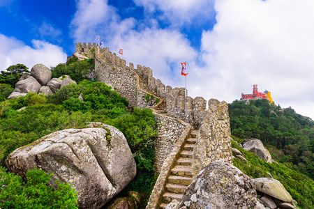 moors: Sintra, Portugal at Castle of the Moors wall with Pena National Palace in the distance.