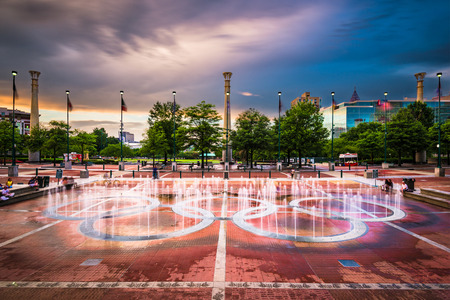 ATLANTA, GEORGIA - AUGUST 21, 2016: Visitors play in Centennial Olympic Parks landmark fountains. The Park was built for the 1996 Summer Olympics and remains a popular destination.