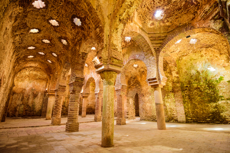 bathhouse: RONDA, SPAIN - OCTOBER 5, 2014: The Arab Public Baths dating from the 11th-12th Centuries. They are considered some of the best preserved baths of their kind on the Iberian Peninsula.