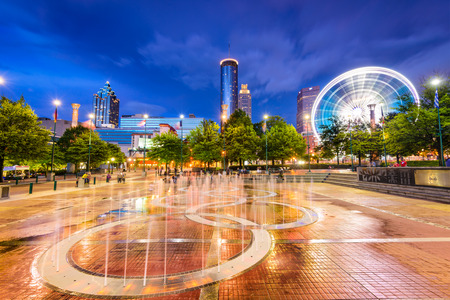 olympic: ATLANTA, GEORGIA - AUGUST 21, 2016: Visitors play in Centennial Olympic Parks landmark fountains. The Park was built for the 1996 Summer Olympics and remains a popular destination.