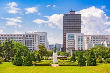 BATON ROUGE, LOUISIANA - MAY 12, 2016: The Huey Long memorial and the downtown Baton Rouge skyline.