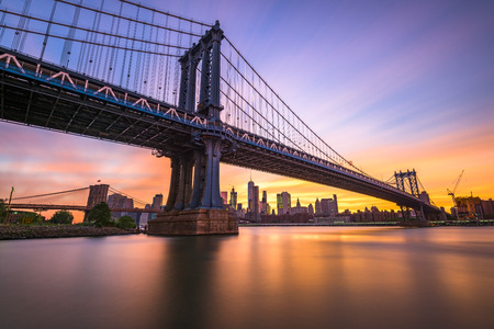 manhattan bridge: New York City at the Manhattan Bridge spanning the East River during sunset. Stock Photo