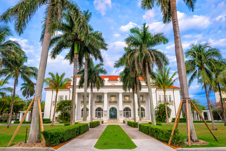 west gate: WEST PALM BEACH, FLORIDA - APRIL 4, 2016: The Flagler Museum exterior and grounds. The beaux arts mansion was constructed by Henry Flagler. Editorial