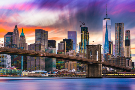 financial district: New York City skyline with the Brooklyn Bridge and Financial district on the East River.