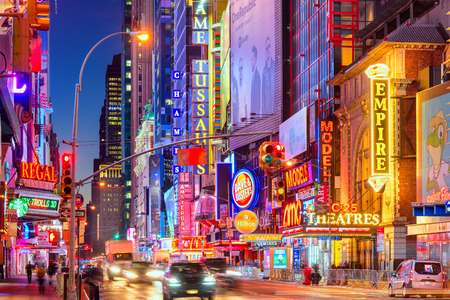 NEW YORK CITY - NOVEMBER 14, 2016: Traffic moves below the illuminated signs of 42nd Street. The landmark street is home to numerous theaters, stores, hotels, and attractions.