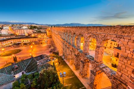 Segovia, Spain town view at Plaza del Azoguejo and the ancient Roman aqueduct. Stock Photo