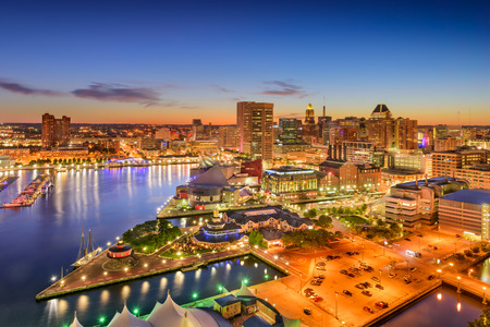 office building: Baltimore, Maryland, USA inner harbor and downtown skyline at twilight.