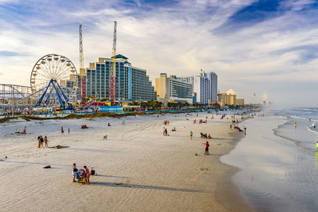 city and county building: DAYTONA BEACH, FLORIDA - FEBRUARY 2, 2015: Beachgoers on Daytona Beach.